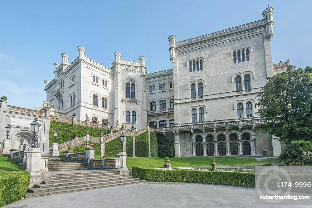 Exterior of Miramare Castle with lawns and steps, Trieste, Italy.