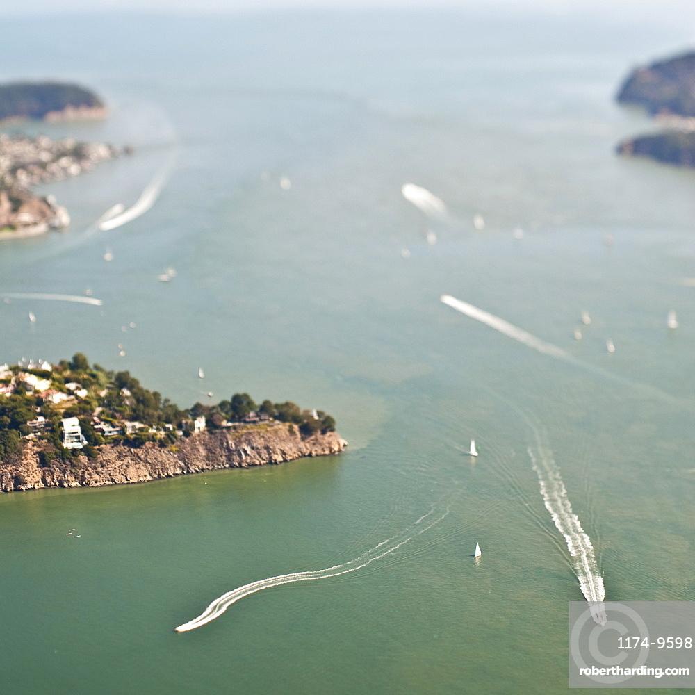 Boats in ocean sailing around islands
