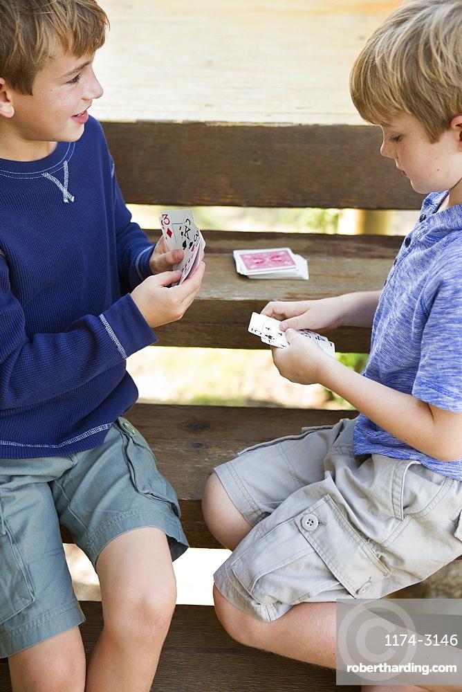 Two brothers playing cardsAustin, Texas, USA