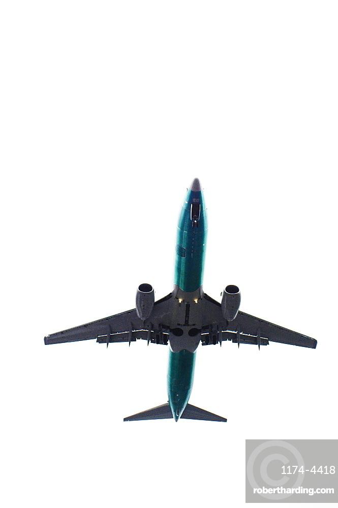 The underside of an aeroplane in flight.