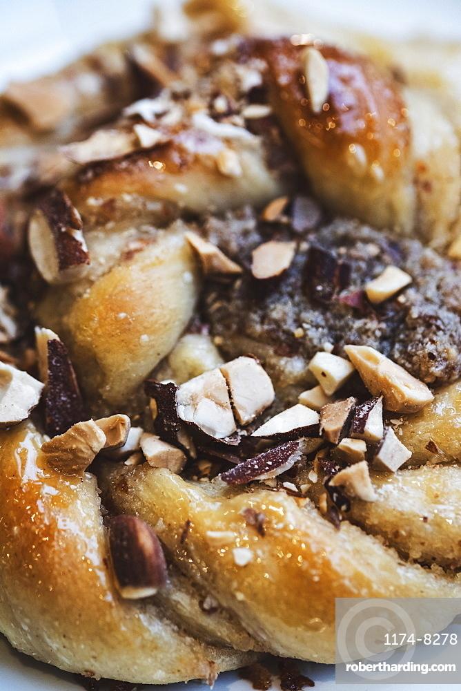 A platted glazed fresh baked cinnamon bun