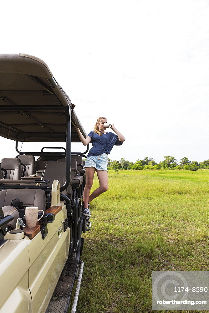Thirteen year old girl on safari vehicle, Botswana
