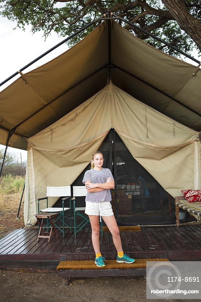 12 year old girl and tent, Kalahari Desert, Makgadikgadi Salt Pans, Botswana