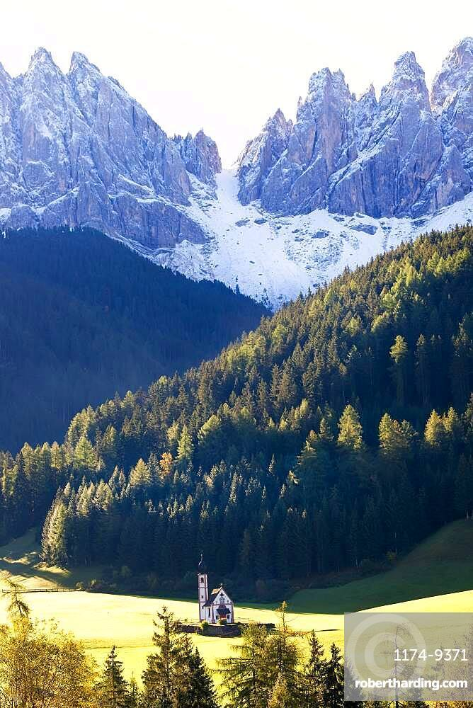 Saint John's Church in the Val di Funes surrounded by mountains, South Tyrol, Italy