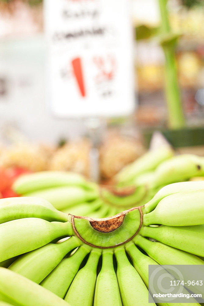 Close-up of bunch of bananas on market stall