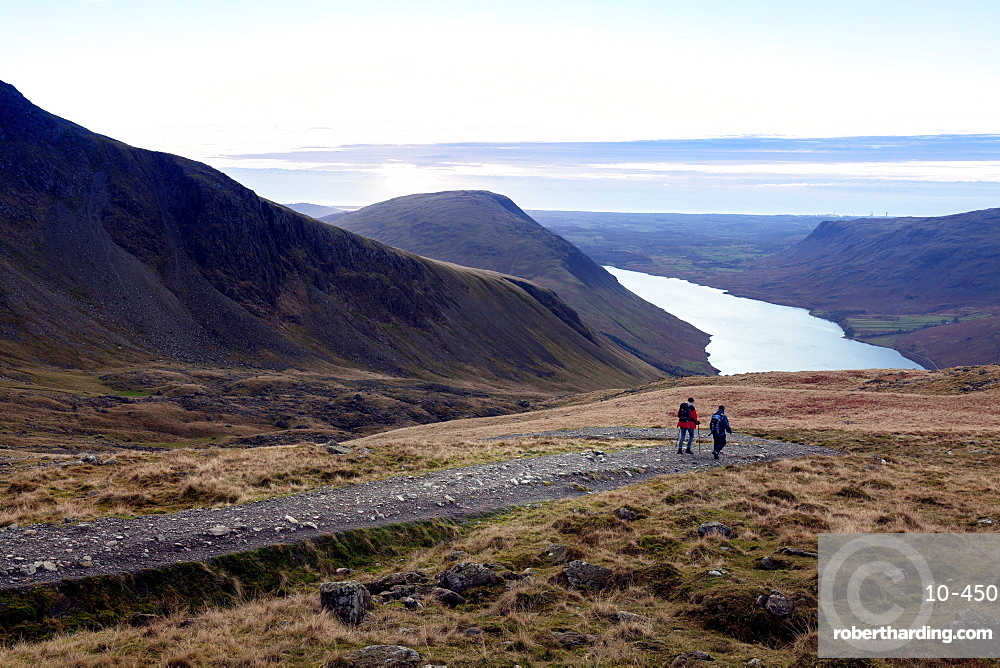 Two men descend from Scafell Pike towards Wast Water, Lake District, Cumbria, England, United Kingdom, Europe
