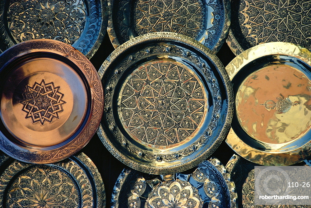 Close-up of copper trays for sale, Morocco, Africa