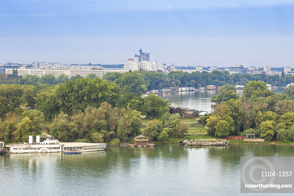 View of the confluence of the Sava and Danube rivers with Genex tower in distance, Belgrade, Serbia, Europe