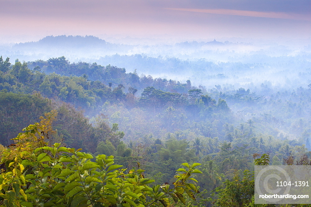 Mist hovering over Borobudur Temple at dawn, Magelang, Java, Indonesia, Southeast Asia, Asia