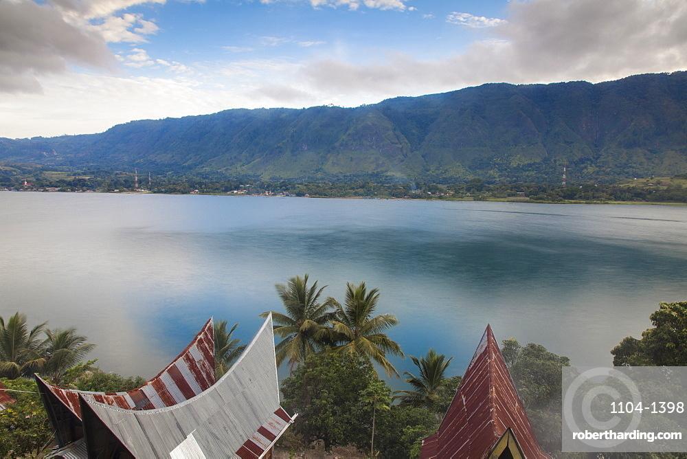 Typical Batak houses overlooking Lake Toba, Tuk Tuk, Lake Toba, Samosir Island, Sumatra, Indonesia, Southeast Asia, Asia