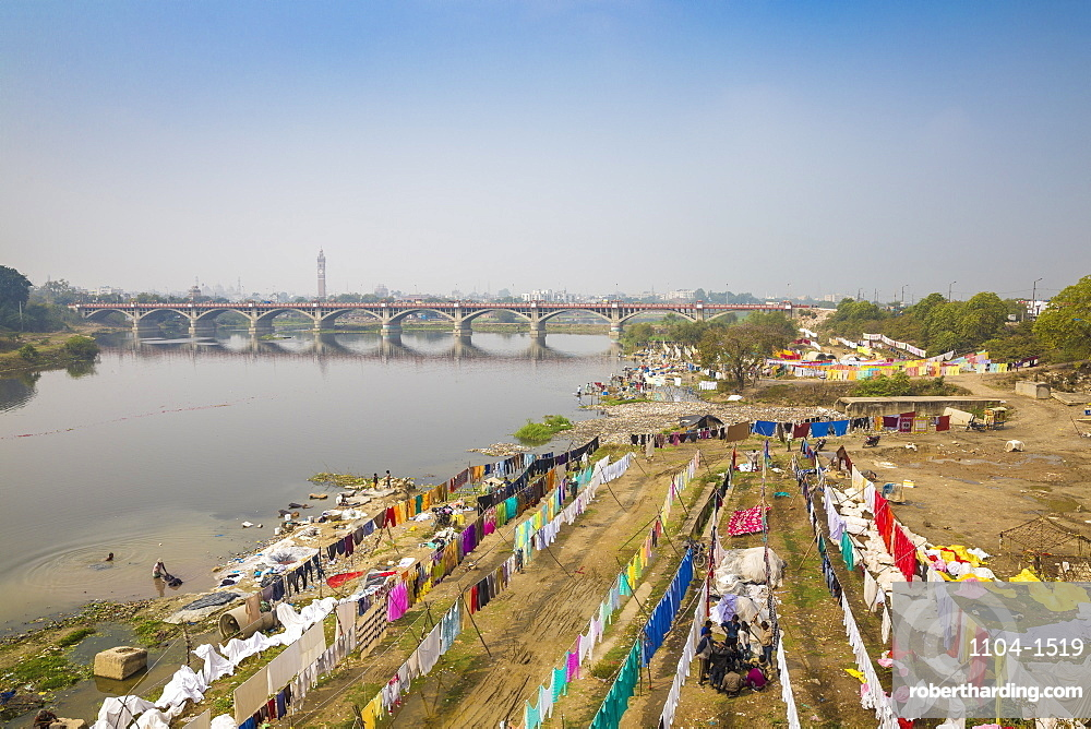 India, Uttar Pradesh, Lucknow, Washing drying on banks of Gomti River