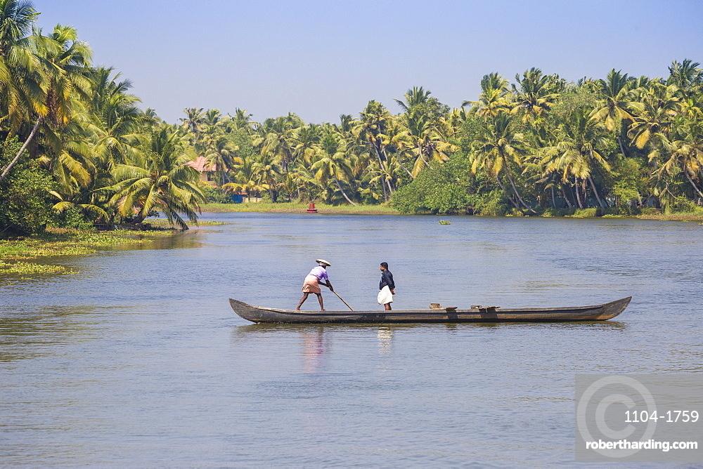 Men in dugout canoe, Backwaters, Kollam, Kerala, India, Asia
