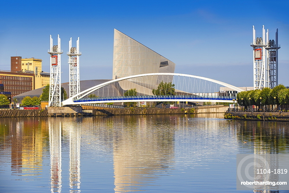 The Lowry footbridge and Imperial War Museum North, Salford Quays, Manchester, England, United Kingdom, Europe