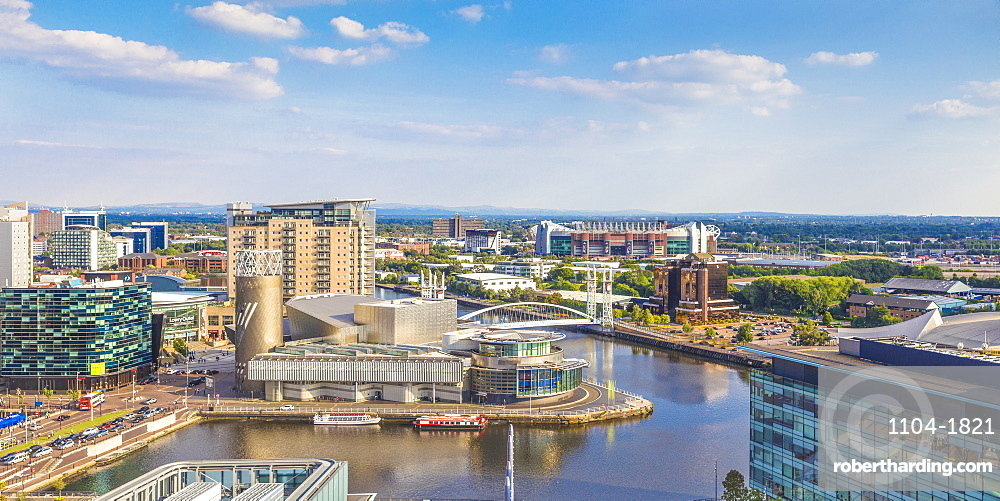 View of Salford Quays looking towards the Lowry Theatre and Old Trafford, Manchester, Greater Manchester, England, United Kingdom, Europe