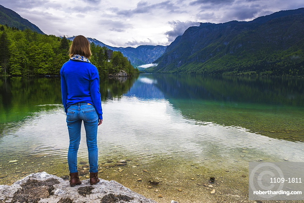 Tourist visiting Lake Bohinj, Triglav National Park, Julian Alps, Slovenia, Europe