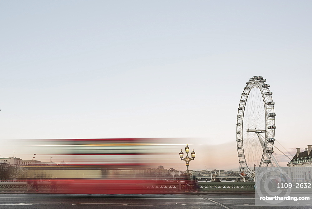The London Eye, with red London bus on Westminster Bridge at sunset, South Bank, London, England, United Kingdom, Europe