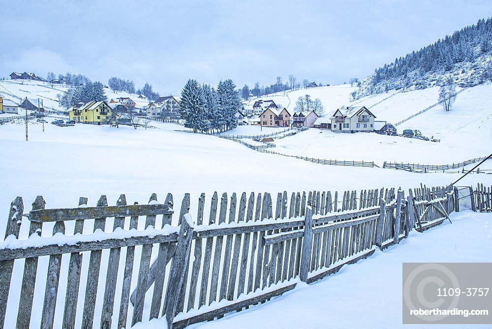 Village near Bran in the Carpathian Mountains in Winter, Transylvania, Romania, Europe