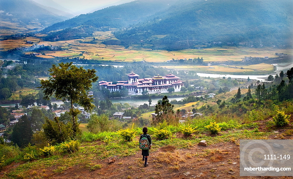 Young child looking down at Punakha Dzong, the second largest and second oldest dzong in Bhutan.