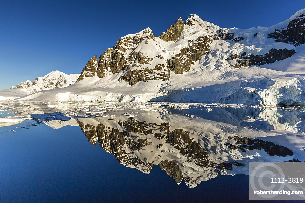Reflections in the calm waters of the Lemaire Channel, Antarctica, Polar Regions