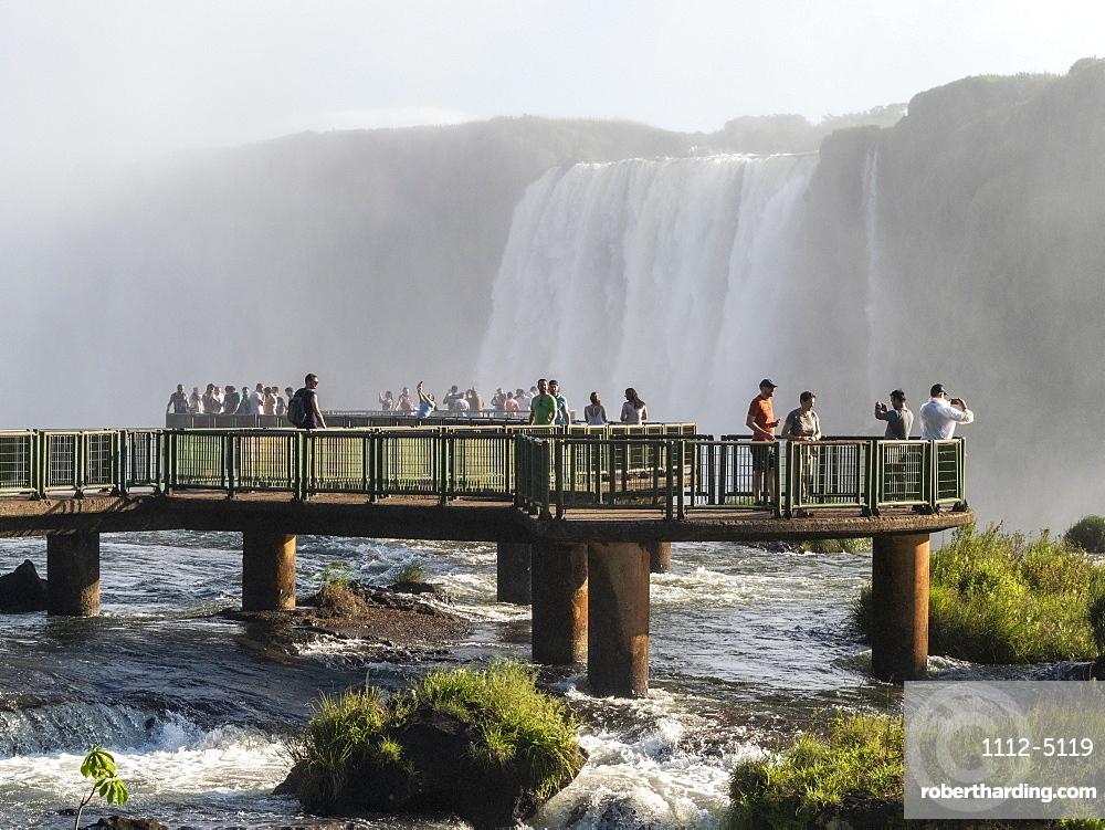 Tourists on viewing platform at Iguacu Falls (Cataratas do Iguacu), UNESCO World Heritage Site, from the Brazilian side, Parana, Brazil, South America