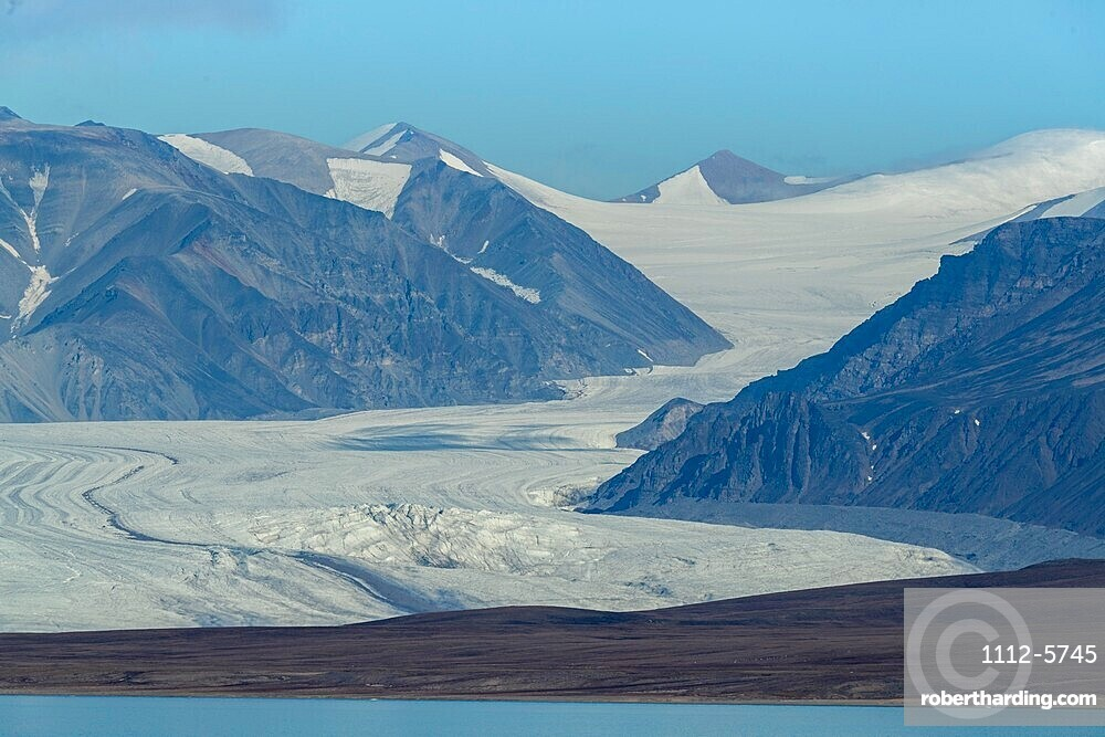 Tidewater glaciers and ice-capped mountains in Eclipse Sound, Nunavut, Canada.