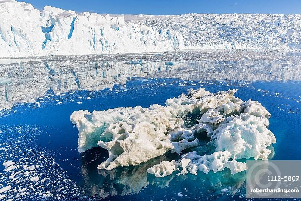 Tidewater glacier and brash ice in Cierva Cove, Hughes Bay, Antarctica.