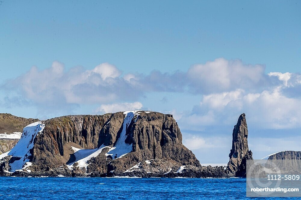 Basalt pinnacle and cliffs in English Strait in the South Shetland Islands, Antarctica.