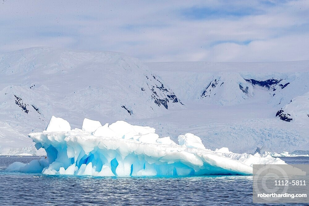 Snow-covered mountains, glaciers, and icebergs in Lindblad Cove, Charcot Bay, Trinity Peninsula, Antarctica.