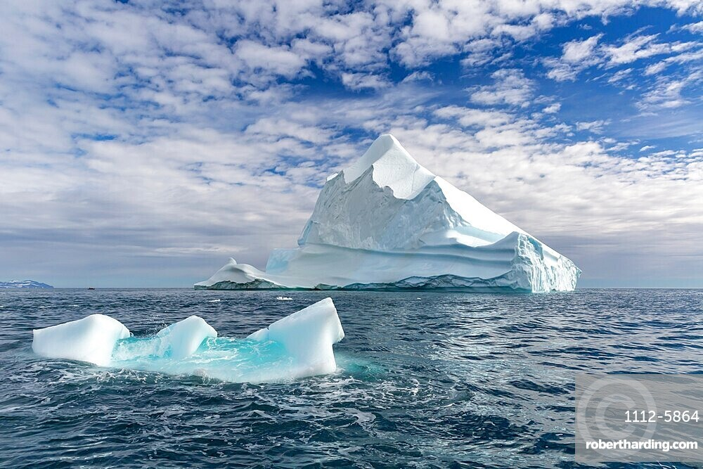 Huge icebergs at Cape Brewster, the easternmost point of the jagged and mountainous Savoia Peninsula, Greenland.