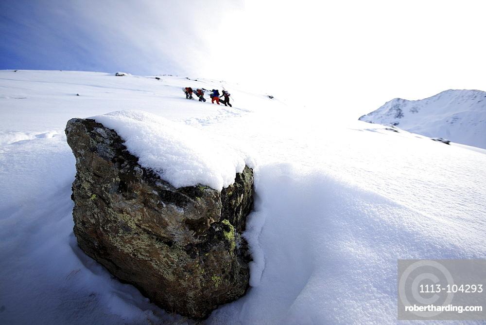 A group of people walking through the snow, Ski Region Paznaun, Tyrol, Austria