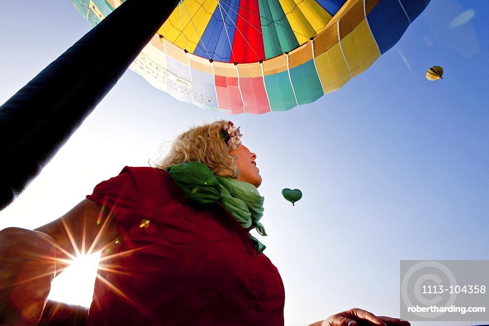 Young woman in a hot-air balloon, Styria, Austria