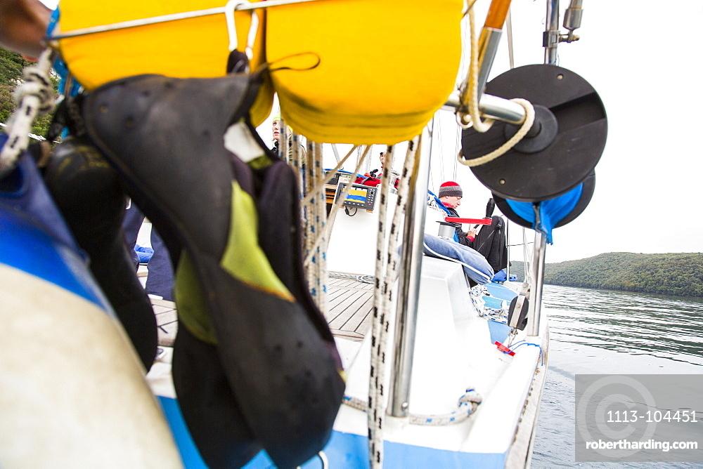 Climbing shoes on a sailing boat, Lim canal, Istria, Croatia