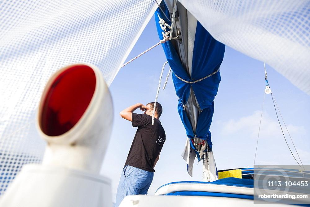Man on a sailing boat looking at view, Istria, Croatia