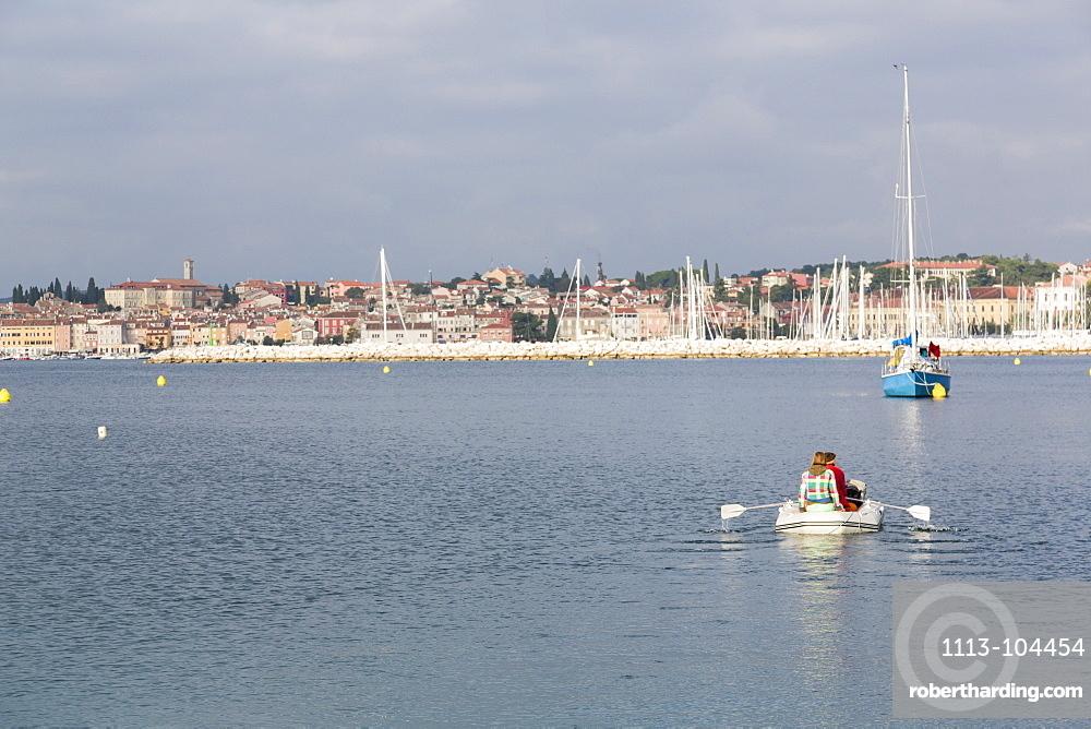 Man and woman in a dinghy, Rovinj, Istria, Croatia