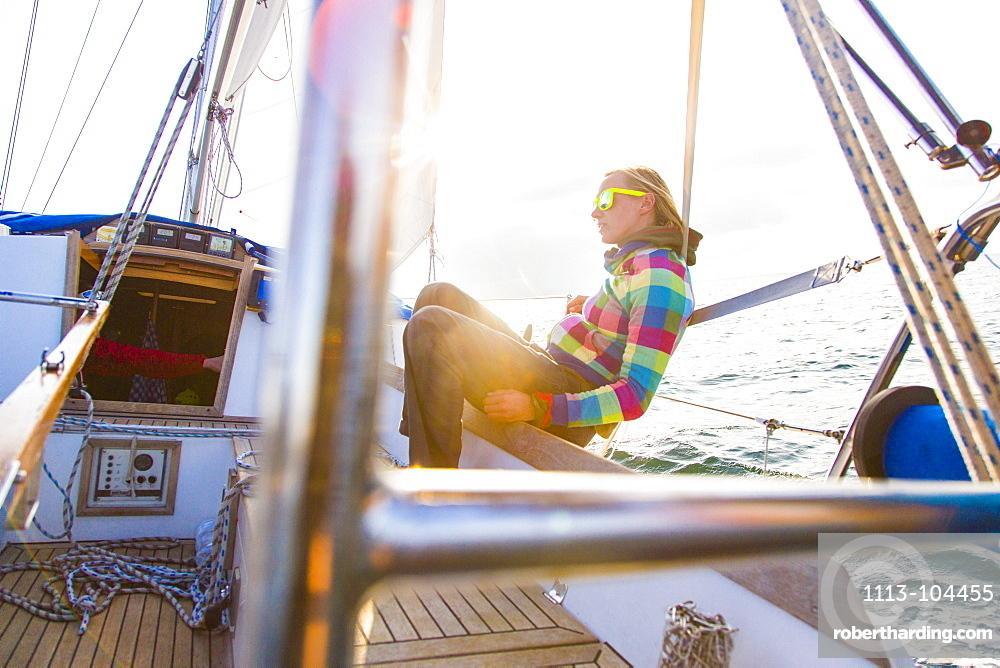 Woman on a sailing boat in sunset, Istria, Croatia