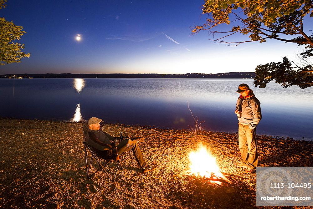 Two men at a campfire, Lake Starnberg, Berg, Upper Bavaria, Germany