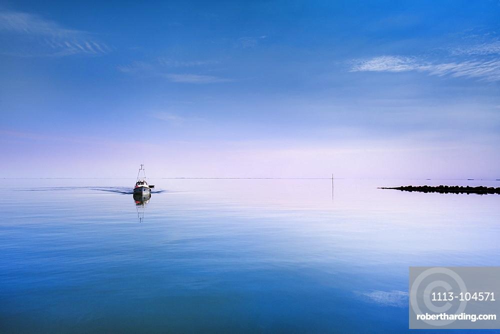 Boat in calm water, Hallig Langeness, North Frisian Islands, Schleswig-Holstein, Germany