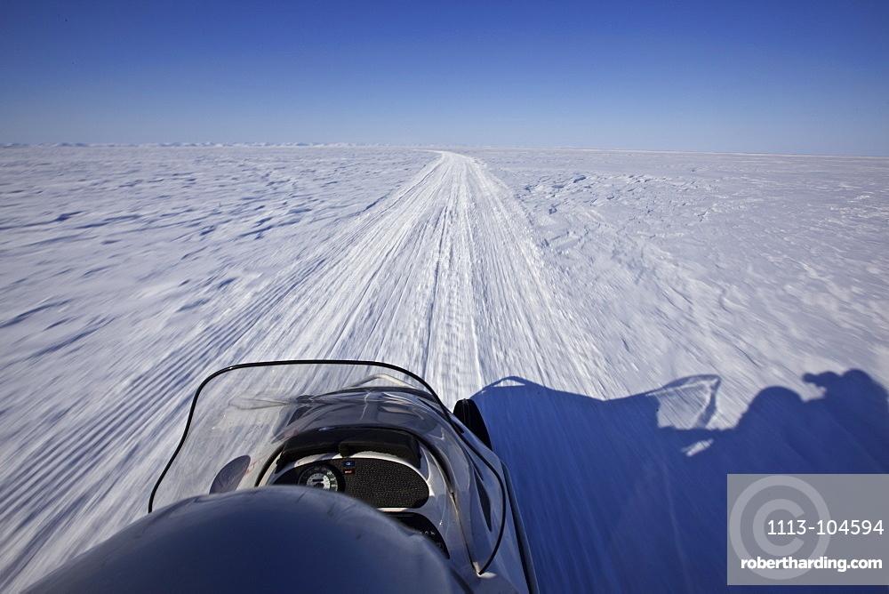Snowmobile driving on the frozen ocean, Chukotka Autonomous Okrug, Siberia, Russia