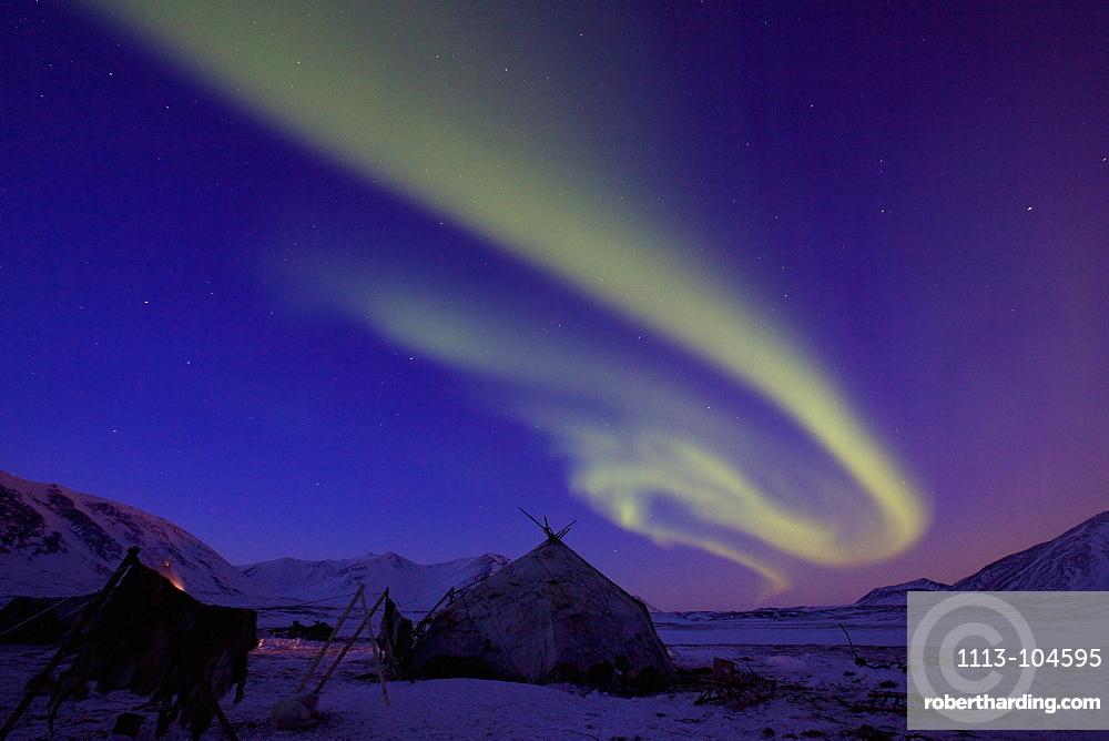 Aurora, aurora borealis, over the Yarangas of Reindeer nomads, Chukotka Autonomous Okrug, Siberia, Russia