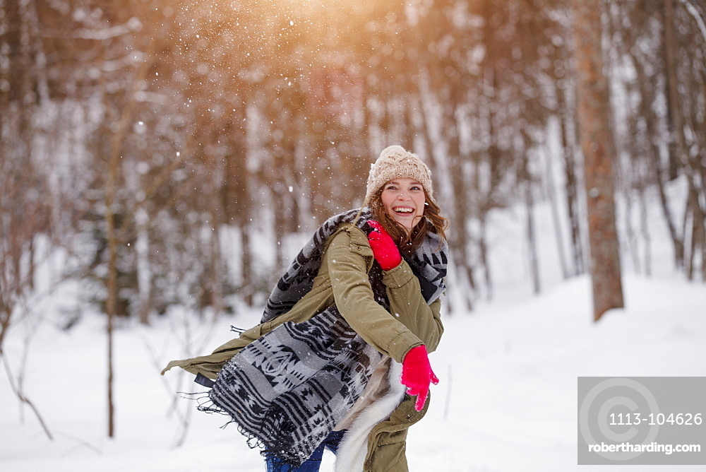Young woman in snown, Spitzingsee, Upper Bavaria, Germany