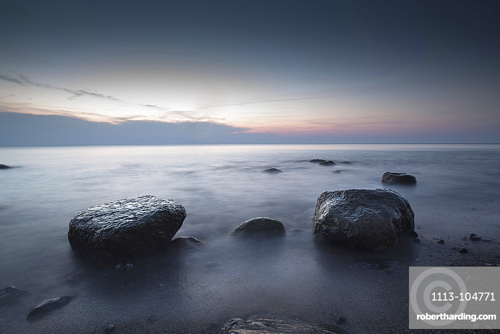 Large stones on a pebble beach at the Baltic Sea in the evening mood, Wustrow, Darss, Mecklenburg Vorpommern, Germany