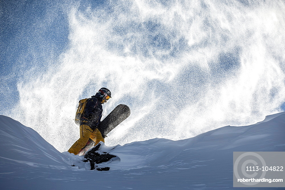 Young female snowboarder standing on the top of a mountain, Pitztal, Tyrol, Austria
