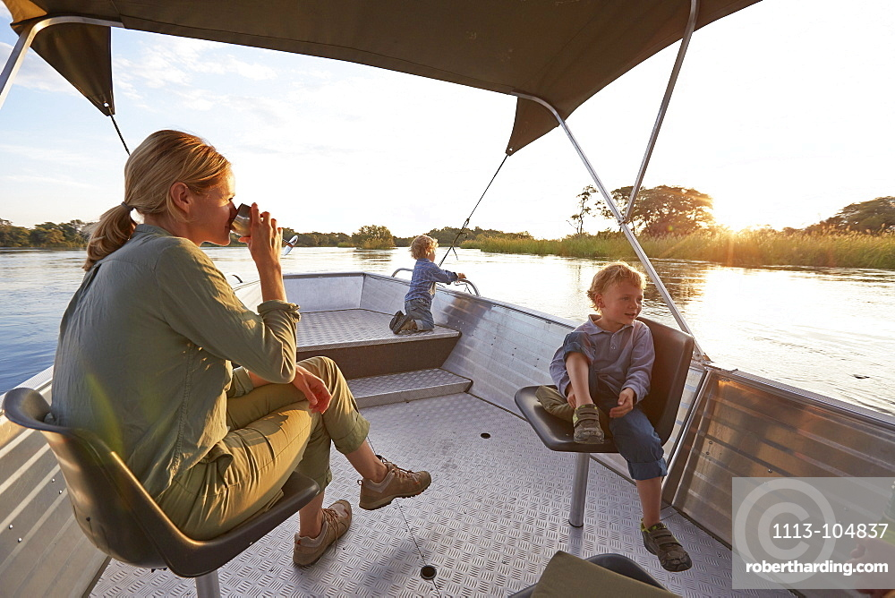 Family having a boat trip on the Kunene River, Kaokoland, Namibia