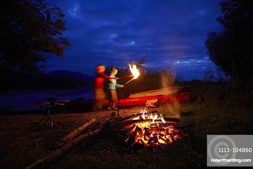 Children at bonfire, lake Staffelsee, Seehausen, Bavaria, Germany