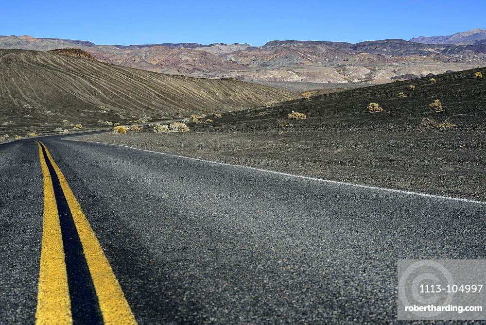 Road leading through volcanic desert near Ubehebe Crater in Death Valley National Park, California, USA, America