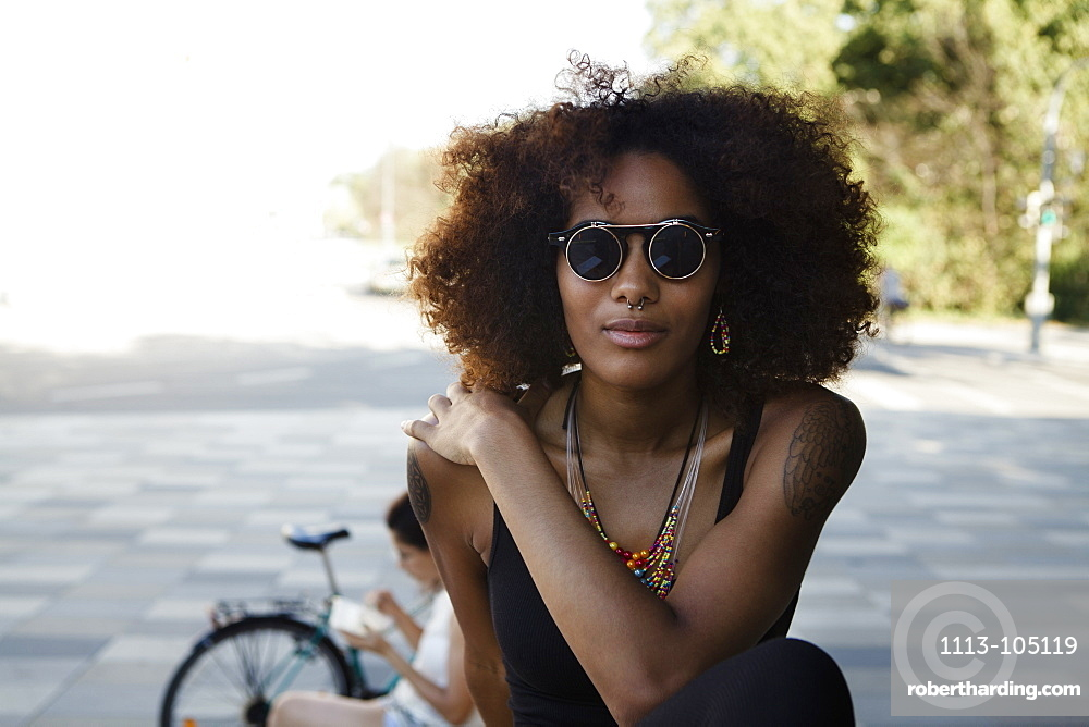 Portrait of a young afro-american woman in urban scenery, Munich, Bavaria, Germany