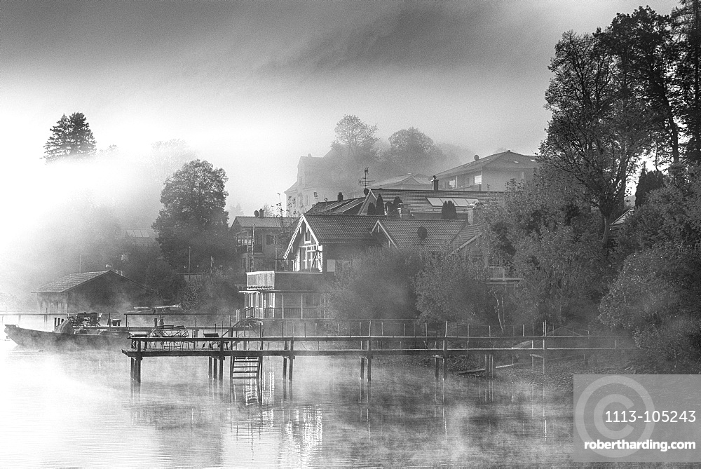 Foggy autumn mood at sunrise on Lake Starnberg, Bavaria, Germany