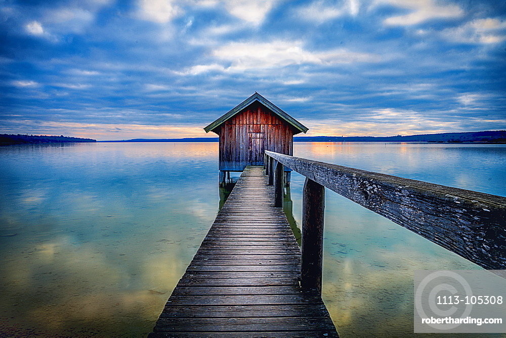 Boathouse at sunset on Ammersee, Stegen, Bavaria, Germany