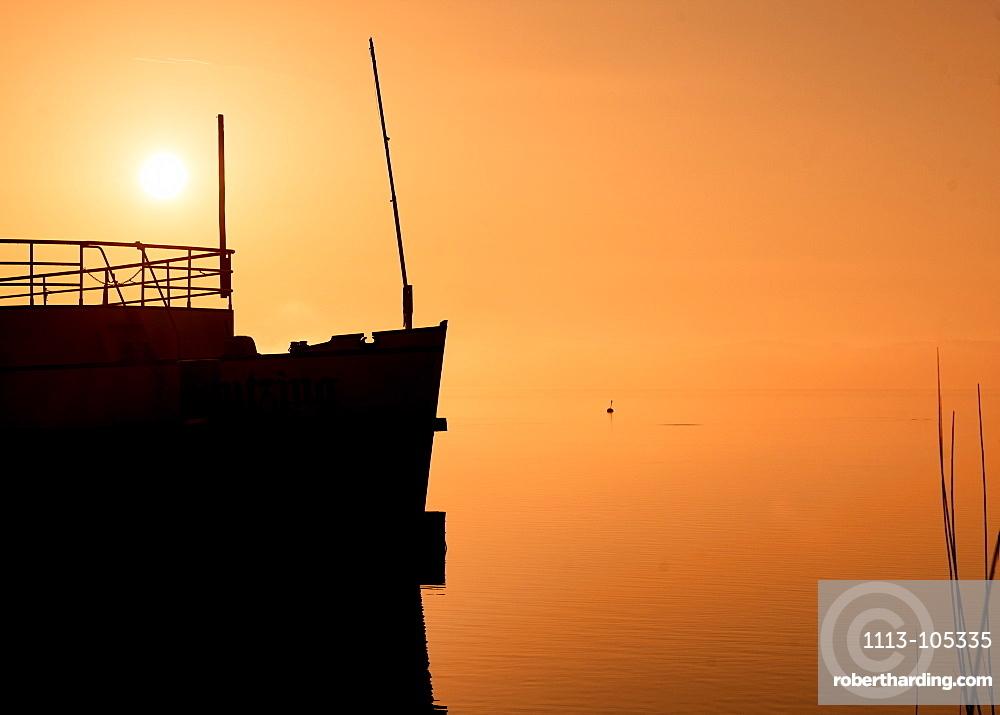 Silhouette ship (museum ship) at sunrise on Lake Starnberg, Tutzing, Bavaria, Germany