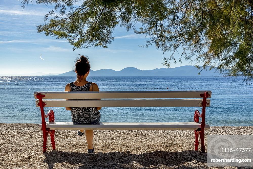 Woman enjoying the view of the Makarska Riviera, Dalmatia, Croatia